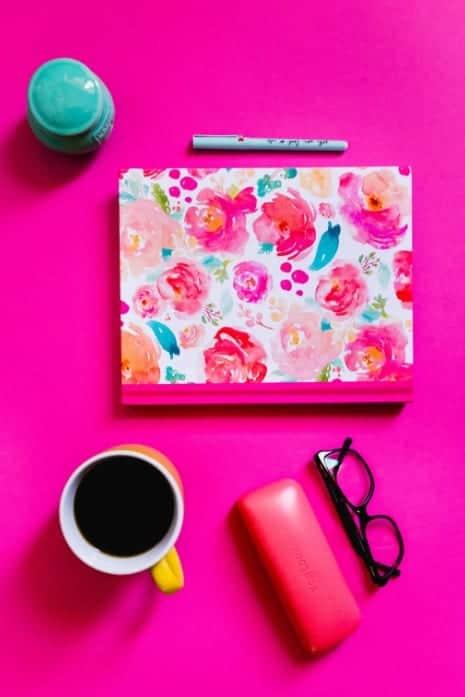 Bold pink desk flatlay