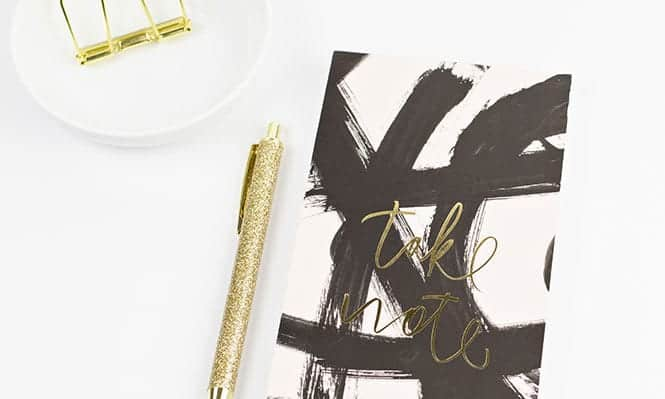 Black and white notebook gold pen featured image