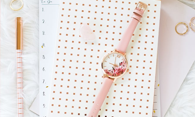 Pink watch flatlay